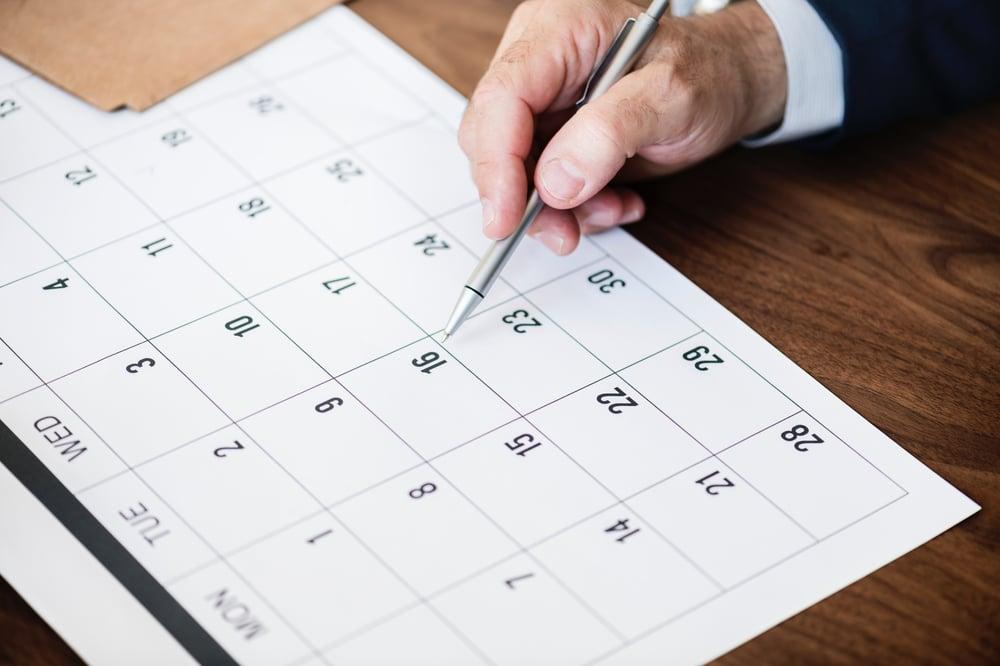 calendar dates desk hand business
